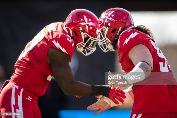 Anthony Johnson of the DC Defenders celebrates with Siupeli Anau after a play against the St. Louis Battlehawks during the first half of the XFL game...