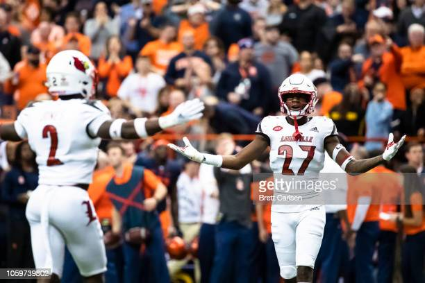 Anthony Johnson of the Louisville Cardinals and Chandler Jones react to Jones being called for pass interference during the third quarter against the...