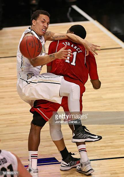 Anthony Johnson of the Purdue Boilermakers collides with Jordan Tyrance of the Nebraska Cornhuskers during a first round game of the Big Ten...