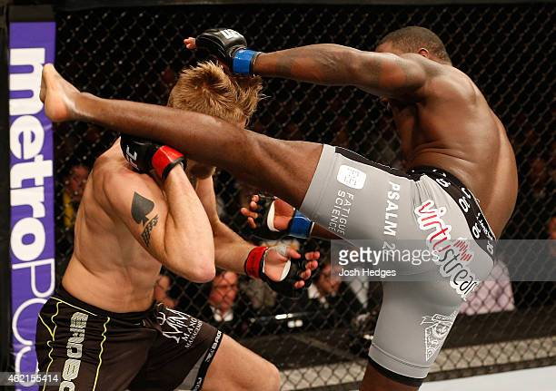 Anthony Johnson of the United States kicks Alexander Gustafsson of Sweden in their light heavyweight bout during the UFC Fight Night event at the...