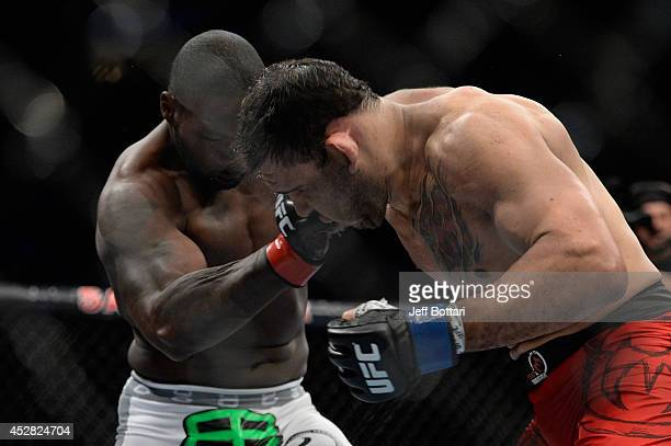 Anthony Johnson punches Antonio Rogerio Nogueira in their light heavyweight bout during the UFC Fight Night event at the SAP Center on July 26 2014...