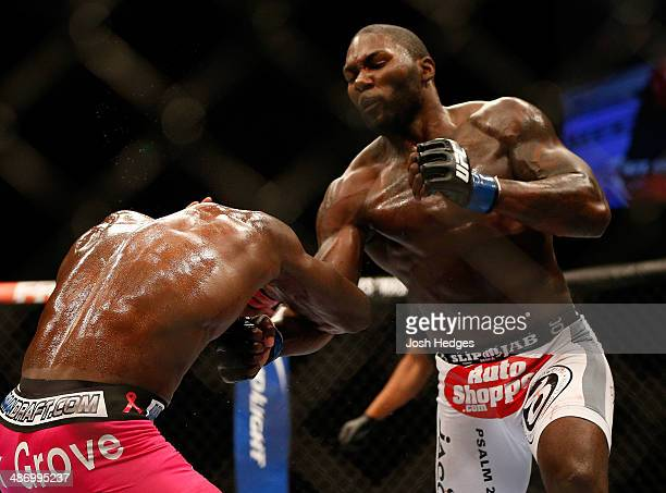 Anthony Johnson punches Phil Davis in their light heavyweight bout during the UFC 172 event at the Baltimore Arena on April 26 2014 in Baltimore...