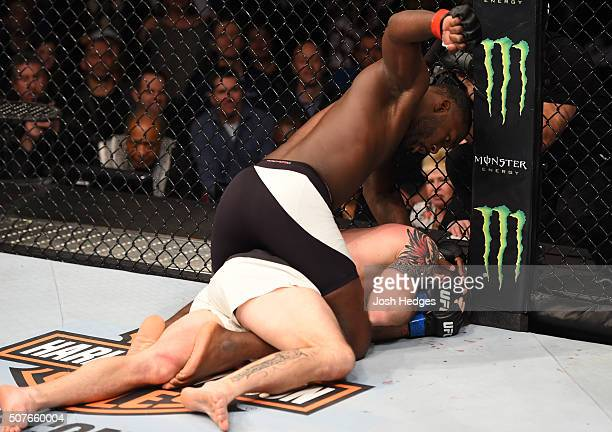 Anthony Johnson punches Ryan Bader in their light heavyweight bout during the UFC Fight Night event at the Prudential Center on January 30 2016 in...