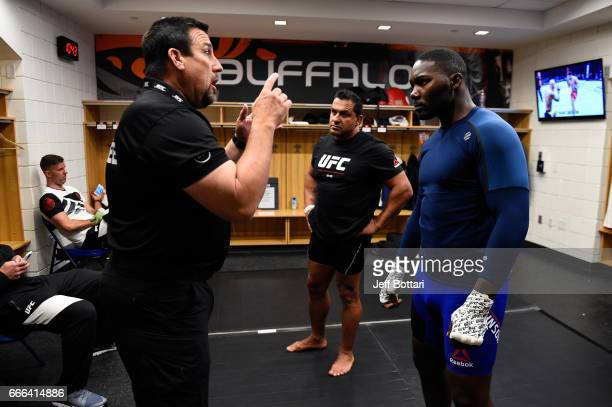 Anthony Johnson receives instructions from John McCarthy backstage during the UFC 210 event at the KeyBank Center on April 8 2017 in Buffalo New York