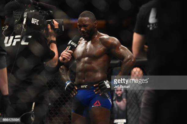 Anthony Johnson speaks to Joe Rogan after being defeated by Daniel Cormier in their UFC light heavyweight championship bout during the UFC 210 event...