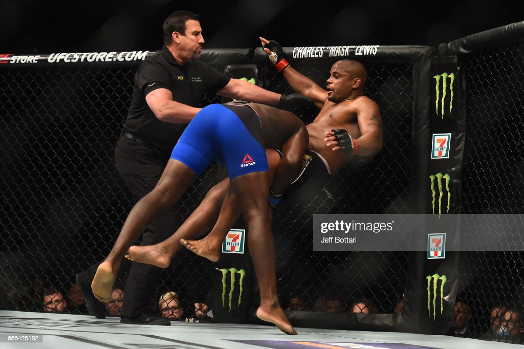 Anthony Johnson takes down Daniel Cormier in their UFC light heavyweight championship bout during the UFC 210 event at the KeyBank Center on April 8, 2017 in Buffalo, New York.
