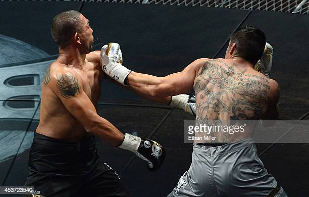 Anthony Johnson throws a left to the face of Dimar Ortuz during their cruiserweight title fight at the inaugural event for BKB Big Knockout Boxing at...
