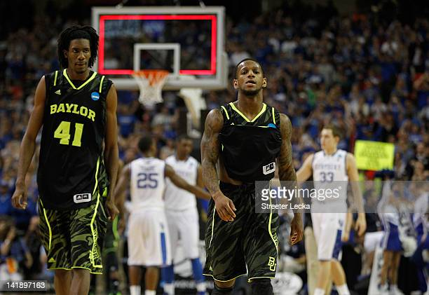 Anthony Jones and Pierre Jackson of the Baylor Bears react after loosing to the Kentucky Wildcats 70 to 82 during the 2012 NCAA Men's Basketball...