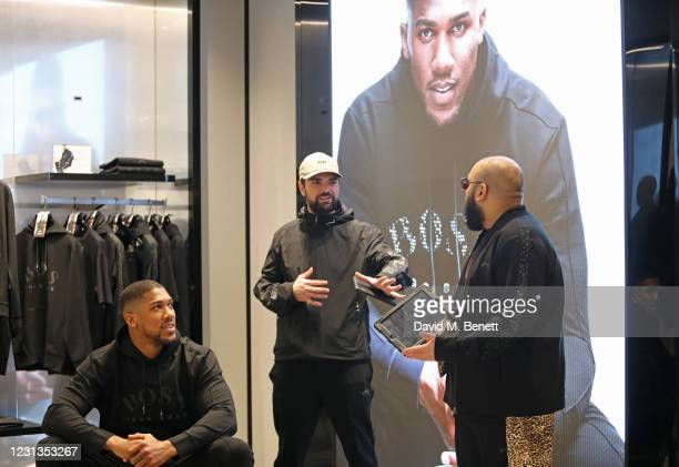 Anthony Joshua, Allan Mustafa aka MC Grindah and Asim Chaudhry aka Chabuddy G attend the unveiling of the BOSS x AJBXNG second capsule collection at...