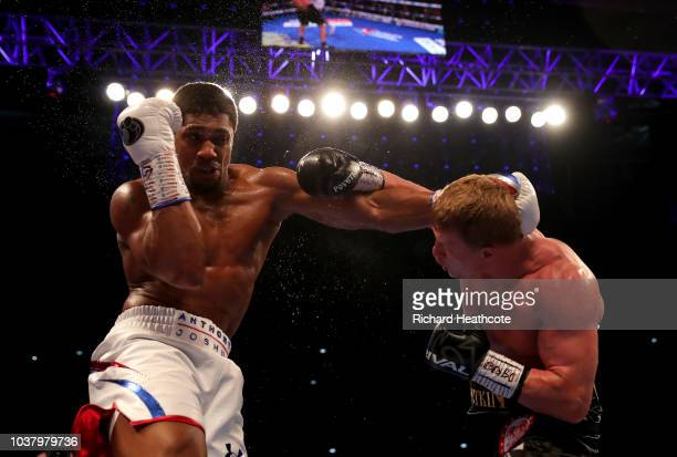 Anthony Joshua and Alexander Povetkin exchange punches during the IBF WBA Super WBO IBO World Heavyweight Championship title fight between Anthony...