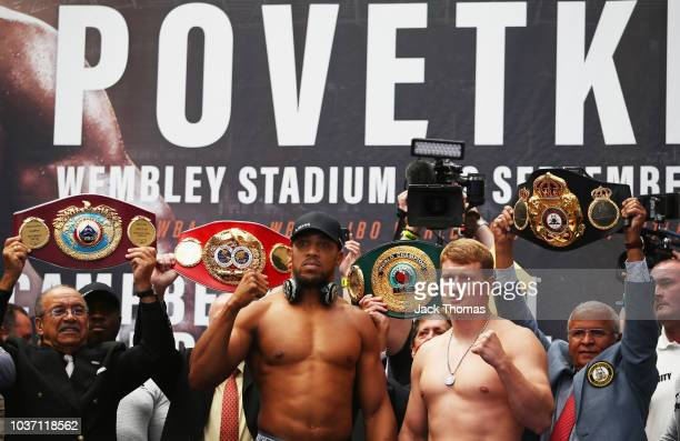 Anthony Joshua And Alexander Povetkin pose for the cameras during the Anthony Joshua And Alexander Povetkin weigh in on September 21 2018 in London...