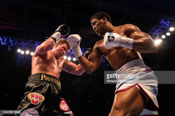 Anthony Joshua and Alexander Povetkin trade punches during the IBF WBA Super WBO IBO World Heavyweight Championship title fight between Anthony...