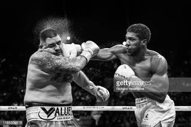 Anthony Joshua and Andy Ruiz Jr during the IBF, WBA, WBO & IBO World Heavyweight Title Fight during the Matchroom Boxing 'Clash on the Dunes' show at...