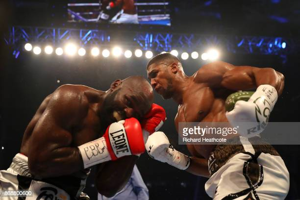Anthony Joshua and Carlos Takam in action during their IBF WBA IBO Heavyweight Championship contest at Principality Stadium on October 28 2017 in...