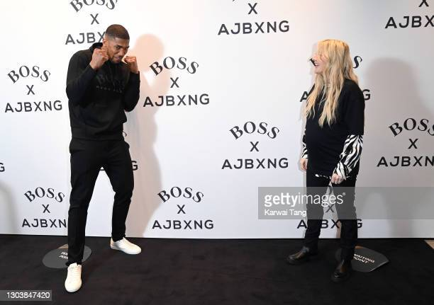 Anthony Joshua and Ellie Goulding attend the unveiling of the new BOSS x Anthony Joshua Collection on February 24, 2021 in London, England.