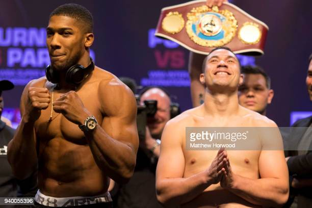 Anthony Joshua and Joseph Parker at the weighin at the Motorpoint Arena on March 30 2018 in Cardiff Wales Anthony Joshua will fight Joseph Parker in...
