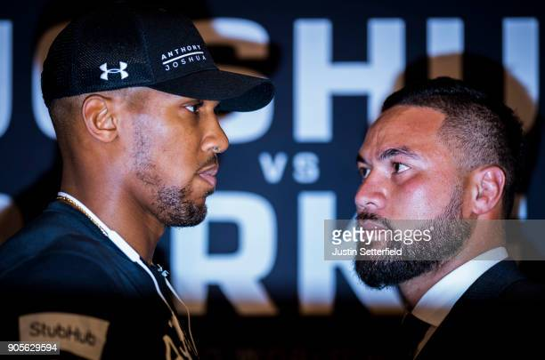 Anthony Joshua and Joseph Parker square up during an Anthony Joshua and Joseph Parker Press Conference at the Dorchester Hotel on January 16 2018 in...