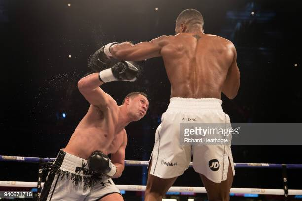 Anthony Joshua and Joseph Parker trade punches during their WBA IBF WBO IBO Heavyweight Championship title fight at Principality Stadium on March 31...
