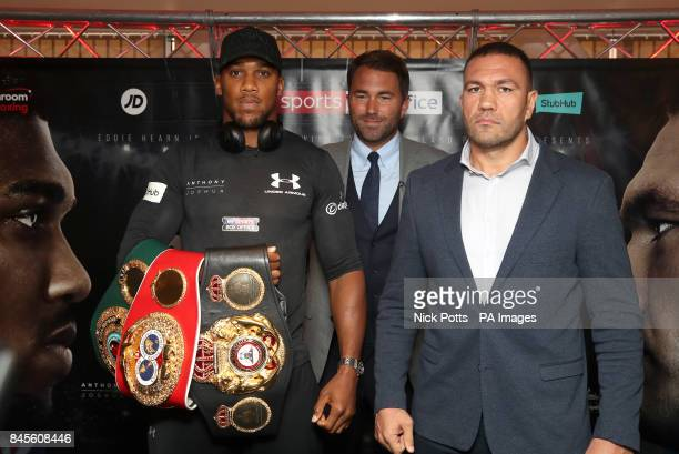 Anthony Joshua and Kubrat Pulev and promoter Eddie Hearn during the press conference at the Principality Stadium Cardiff