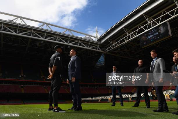 Anthony Joshua and Kubrat Pulev pictured head to head as promoter Eddie Hearn looks on during a media opportunity ahead of their World Heavyweight...