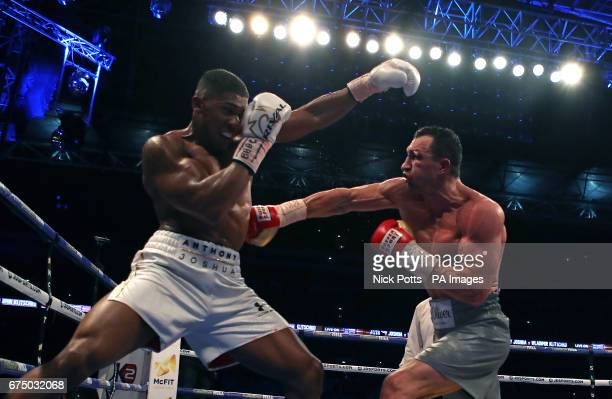 Anthony Joshua and Wladimir Klitschko during their IBF WBA and IBO Heavyweight World Title bout at Wembley Stadium London PRESS ASSOCIATION Photo...