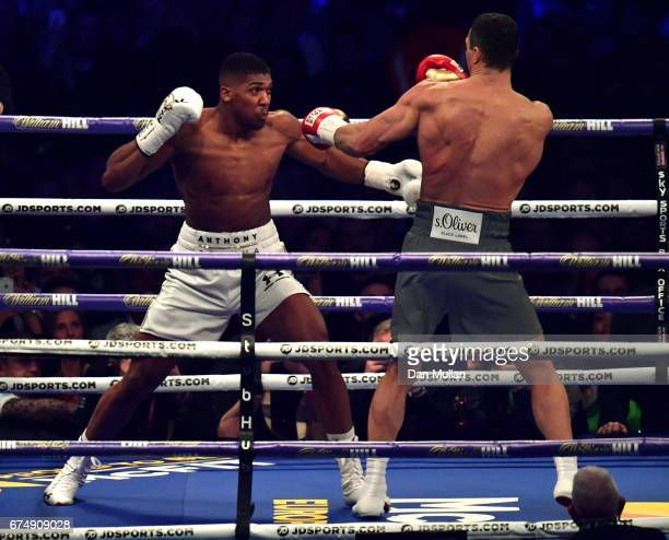 Anthony Joshua and Wladimir Klitschko in action during the IBF WBA and IBO Heavyweight World Title bout at Wembley Stadium on April 29 2017 in London...