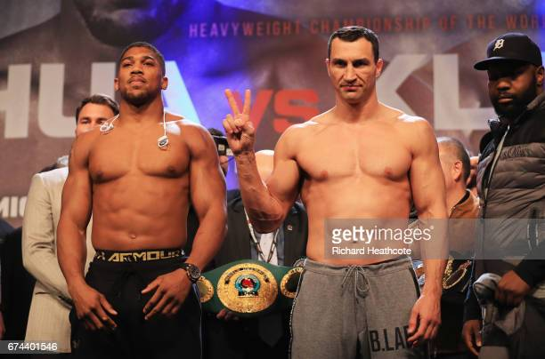 Anthony Joshua and Wladimir Klitschko pose during the weighin prior to the Heavyweight Championship contest at Wembley Arena on April 28 2017 in...