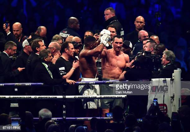 Anthony Joshua and Wladimir Klitschko react after the end of the fight for the IBF WBA and IBO Heavyweight World Title bout at Wembley Stadium on...