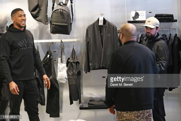 Anthony Joshua, Asim Chaudhry aka Chabuddy G and Allan Mustafa aka MC Grindah attend the unveiling of the BOSS x AJBXNG second capsule collection at...