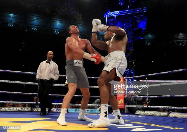 Anthony Joshua catches Wladimir Klitschko with a right hand upper cut in the 11th round of their IBF WBA and IBO Heavyweight World Title bout at...