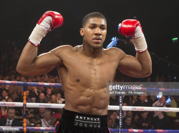 Anthony Joshua celebrates beating Hector Avila during their Heavyweight bout at the SECC Glasgow