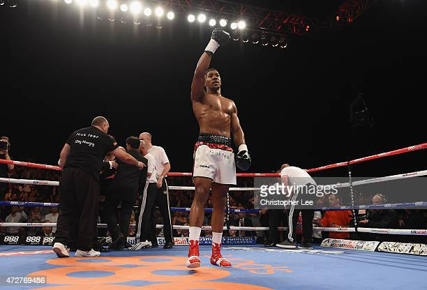 Anthony Joshua celebrates his victory after he knocks out Raphael Zumbano Love during the Heavyweight Contest during Resurrection Fight Night at...