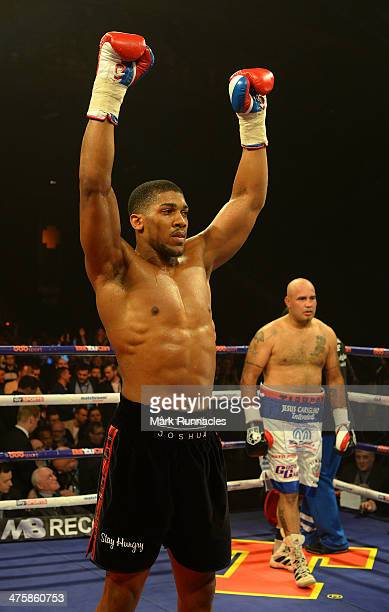 Anthony Joshua celebrates his win over Hecto Avila during an undercard bout at the WBO World Lightweight Championship Boxing match at the Glasgow...