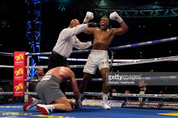 Anthony Joshua celebrates knocking down Wladimir Klitschko in the 5th round during the IBF WBA and IBO Heavyweight World Title bout at Wembley...