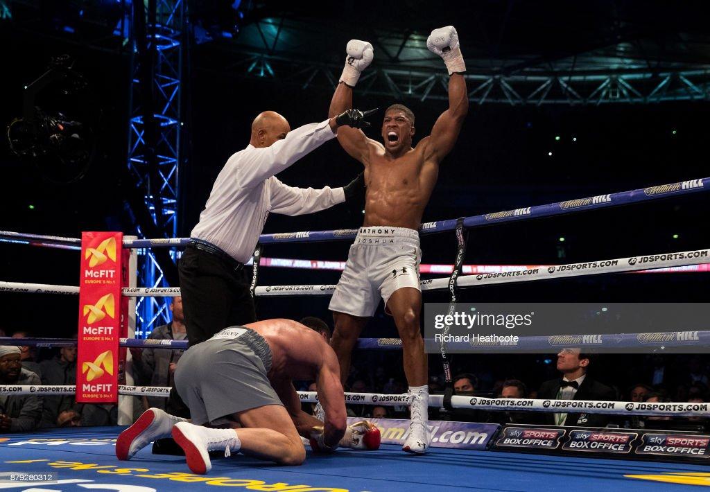 Anthony Joshua (White Shorts) celebrates knocking down Wladimir Klitschko (Grey Shorts) in the 5th round during the IBF, WBA and IBO Heavyweight World Title bout at Wembley Stadium on April 29, 2017 in London, England.