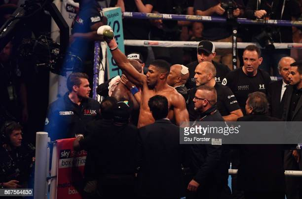 Anthony Joshua celebrates victory after a 10th round stoppage during the IBF, WBA & IBO Heavyweight Championship contest against Carlos Takam at...