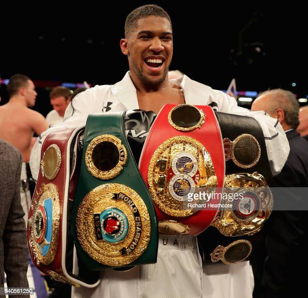 Anthony Joshua celebrates victory after his WBA IBF WBO IBO Heavyweight Championship title fight against Joseph Parker at Principality Stadium on...