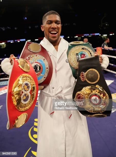 Anthony Joshua celebrates victory after his WBA IBF WBO IBO Heavyweight Championship title fight against Joseph Parker at Principality Stadium on...