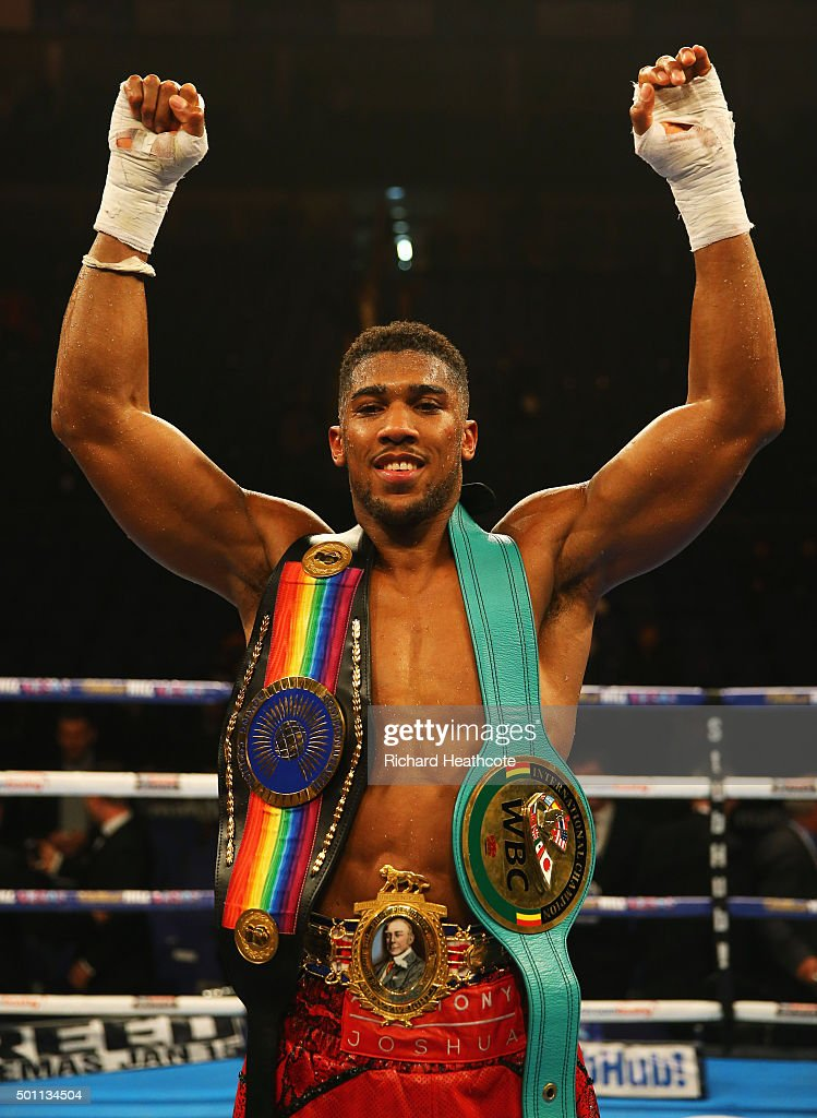 Anthony Joshua celebrates victory over Dillian Whyte with his belts after the British and Commonwealth heavyweight title contest at The O2 Arena on December 12, 2015 in London, England.