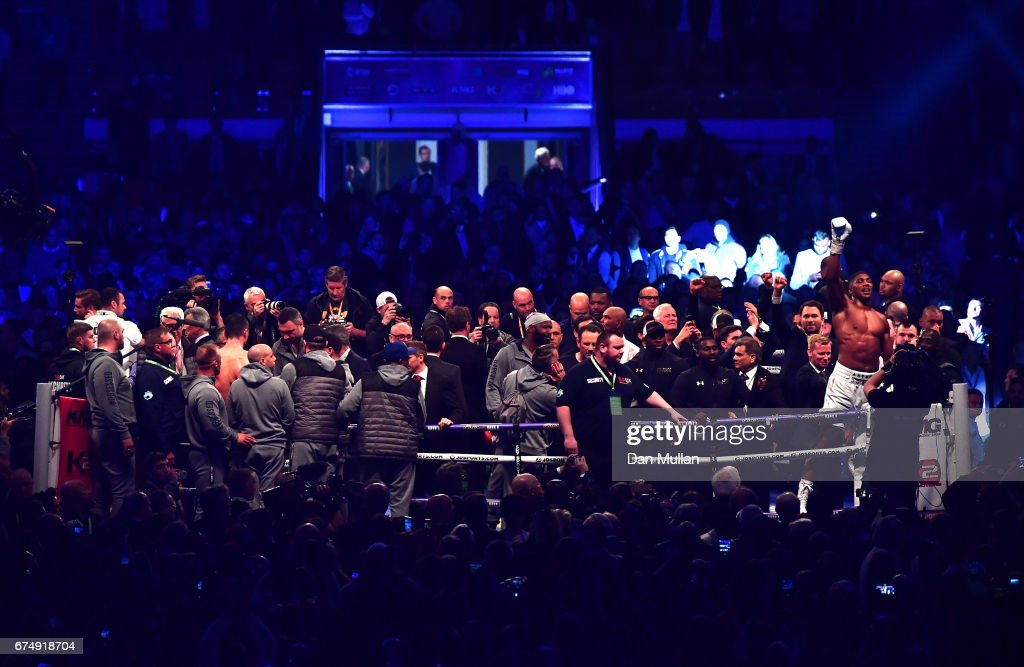 Anthony Joshua (Far Right) celebrates victory over Wladimir Klitschko in the IBF, WBA and IBO Heavyweight World Title bout at Wembley Stadium on April 29, 2017 in London, England.