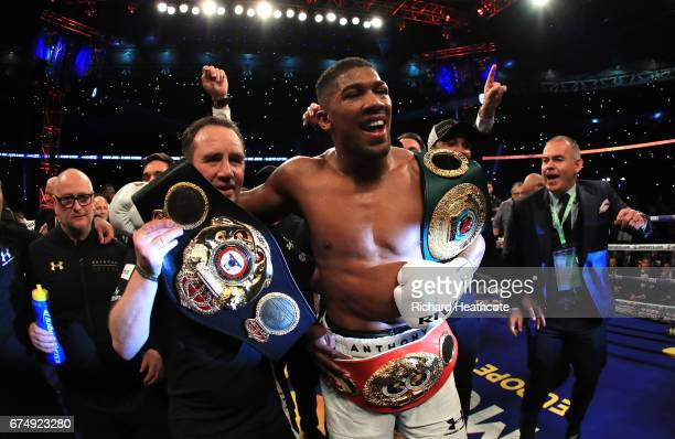 Anthony Joshua celebrates victory over Wladimir Klitschko in the IBF WBA and IBO Heavyweight World Title bout at Wembley Stadium on April 29 2017 in...