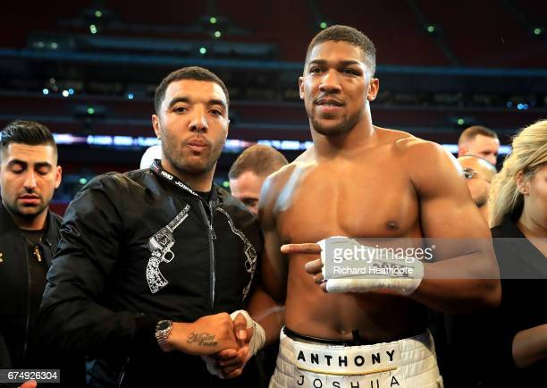 Anthony Joshua celebrates with footballer Troy Deeney after victory over Wladimir Klitschko in the IBF WBA and IBO Heavyweight World Title bout at...