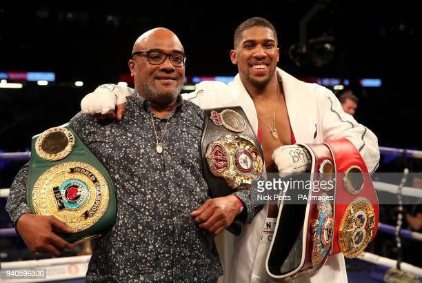 Anthony Joshua celebrates with his father Robert Joshua after victory over Joseph Parker in their WBA IBF WBO and IBO Heavyweight Championship...