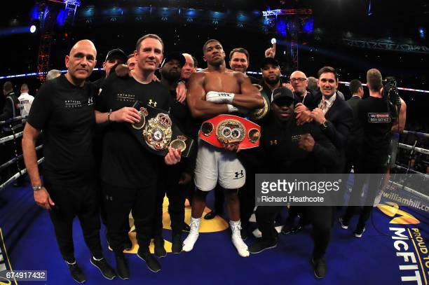 Anthony Joshua celebrates with his team following victory over Wladimir Klitschko in the IBF WBA and IBO Heavyweight World Title bout at Wembley...