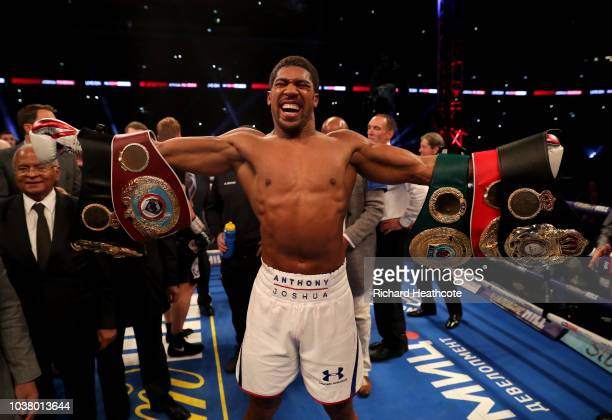 Anthony Joshua celebrates with the IBF WBA Super WBO IBO World Heavyweight belts after the IBF WBA Super WBO IBO World Heavyweight Championship title...