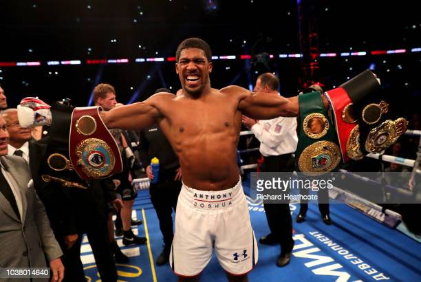 Anthony Joshua celebrates with the IBF WBA Super WBO IBO World Heavyweight belts after the IBF WBA Super WBO IBO World Heavyweight Championship title...