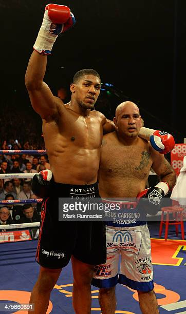 Anthony Joshua clashes with Hector Avila during an undercard bout at the WBO World Lightweight Championship Boxing match at the Glasgow SECC on March...