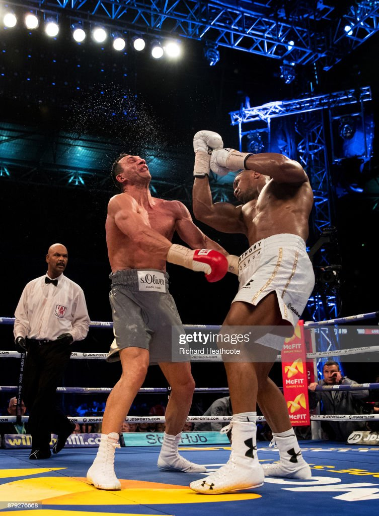 Anthony Joshua (White Shorts) deliveres an upper cut to Wladimir Klitschko (Grey Shorts) in the 11th round during the IBF, WBA and IBO Heavyweight World Title bout at Wembley Stadium on April 29, 2017 in London, England.