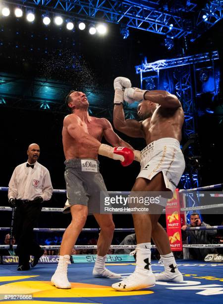 Anthony Joshua deliveres an upper cut to Wladimir Klitschko in the 11th round during the IBF WBA and IBO Heavyweight World Title bout at Wembley...