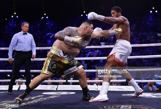 Anthony Joshua dodges a punch from Andy Ruiz Jr during the IBF WBA WBO IBO World Heavyweight Title Fight between Andy Ruiz Jr and Anthony Joshua...